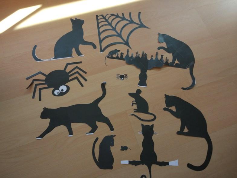 Sombras de gatos, ratones y arañas
