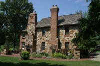 Chimneys, walkway, and patio. The chimney on the left has ...