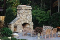 Outdoor fireplace and patio. Natural stone with re-claimed ...