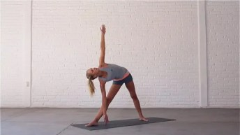 Triangle is a classic standing pose that stretches the calves and hamstrings.