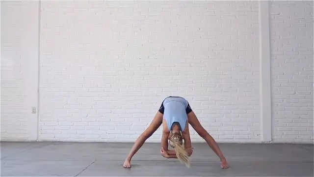 Wide-Legged Forward Bend stretches the calves and hamstrings.
