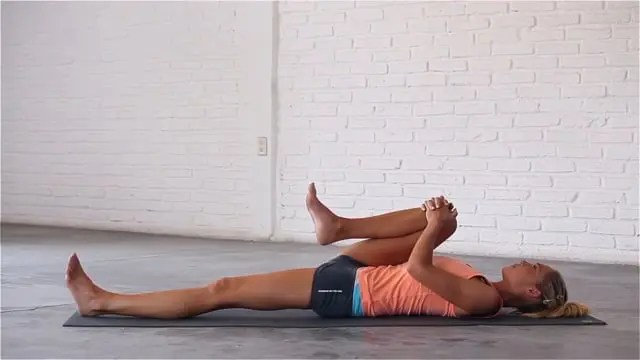 Wind-Relieving pose can help to alleviate lower back pain.