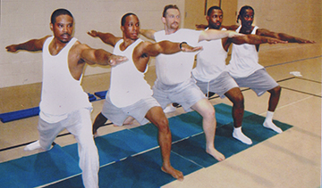 Inmates at Illinois River Correctional Center practice yoga led by Bartosz Leszczynski (2011) L–R: Willie Jackson, Marshawn Feltus, Bartosz Lesczcnyski, Donald Phillips, and William Thompson