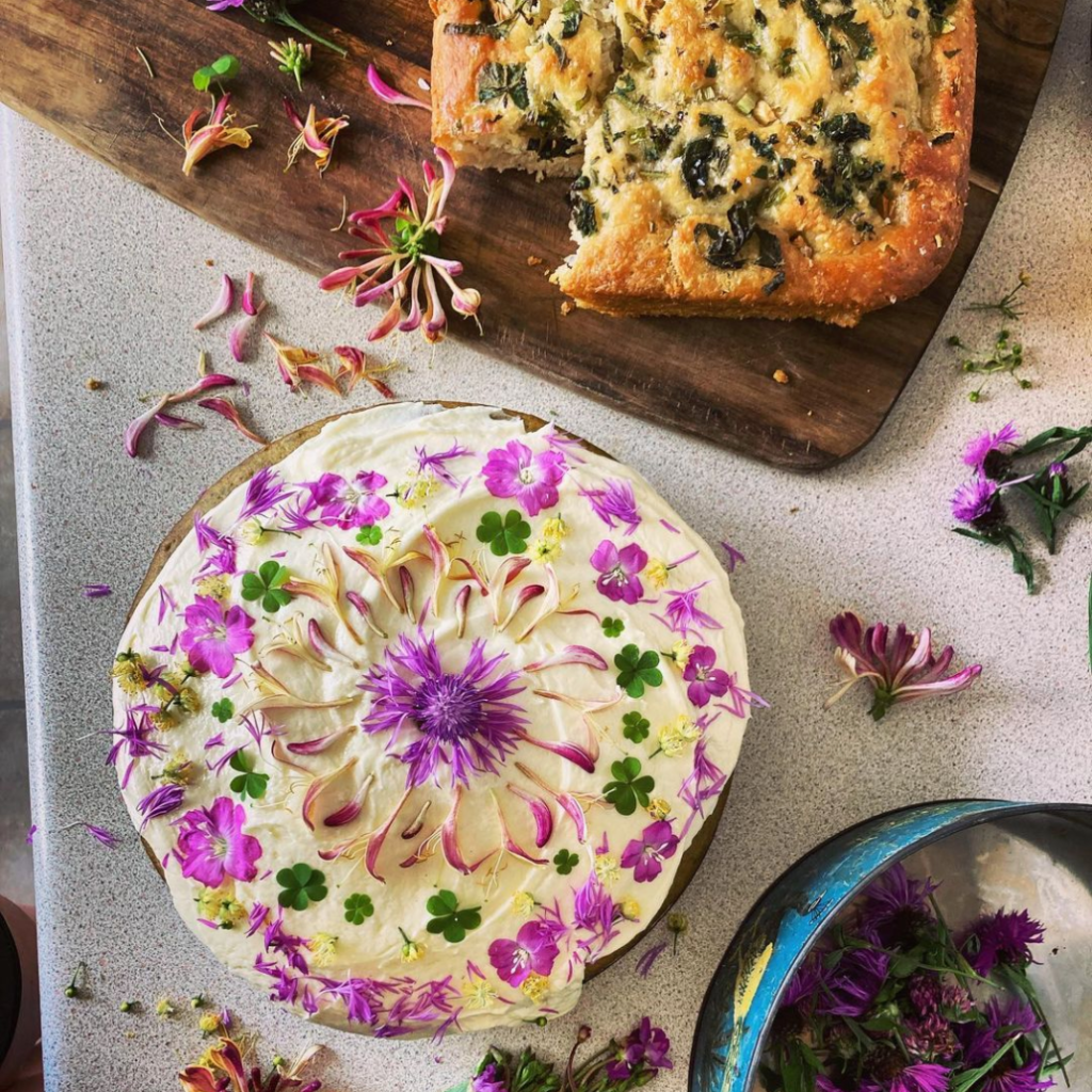 Nettle cake and elderflower butter cream with foraged edible flowers
