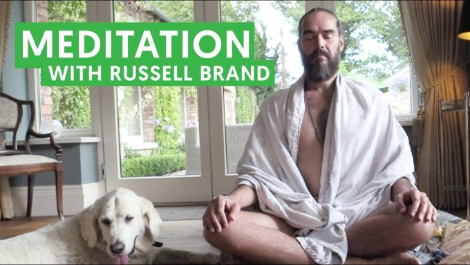 Russell Brand doing Yoga and meditation
