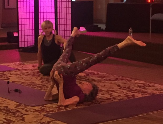 Tao Porchon-Lynch in shoulder stand at Kripalu Retreat Centre