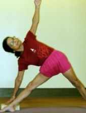 Tiki Misra in Utthita Trikonasana. Photo: Bruce M. Roger, 2008.
