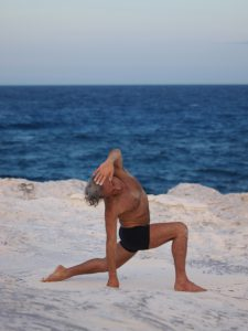 Simon Borg-Olivier in Parsva san calanasana - photo courtesy Mads Becker Joergensen