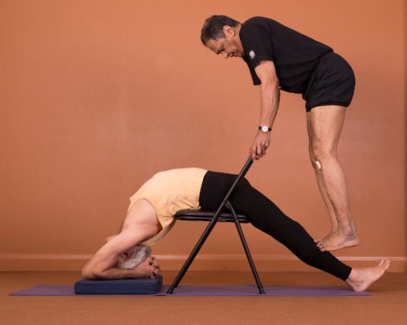 Father Joe at work, Yoga Teacher Magazine