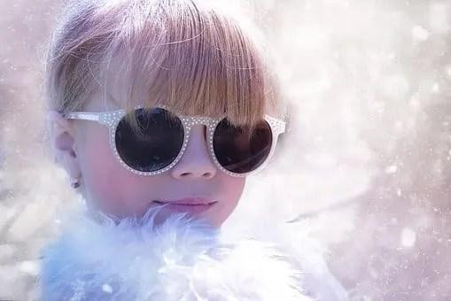 a girl with Rhinestone sunglasses