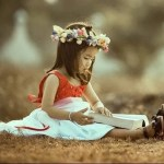 girl reading on the grass