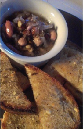 Pickled beans, toast with garlic butter