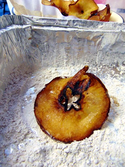 Fried apple tossed in icing sugar