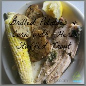 grilled herb stuffed breaded trout, potatoes, and corn