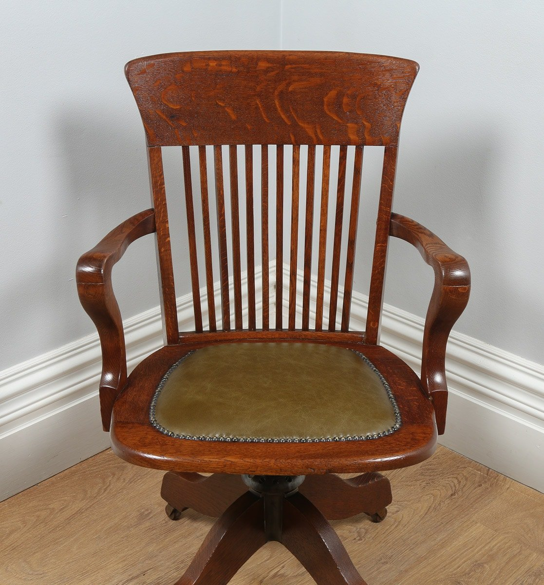 revolving office armchair plastic wicker chairs antique edwardian oak and green leather