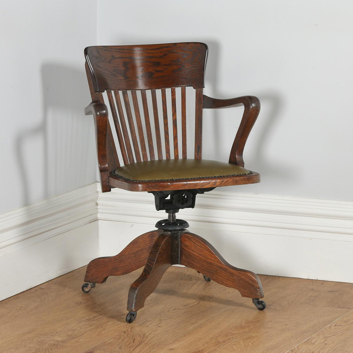 revolving chair for kitchen indoor rocking chairs antique english edwardian oak office desk arm