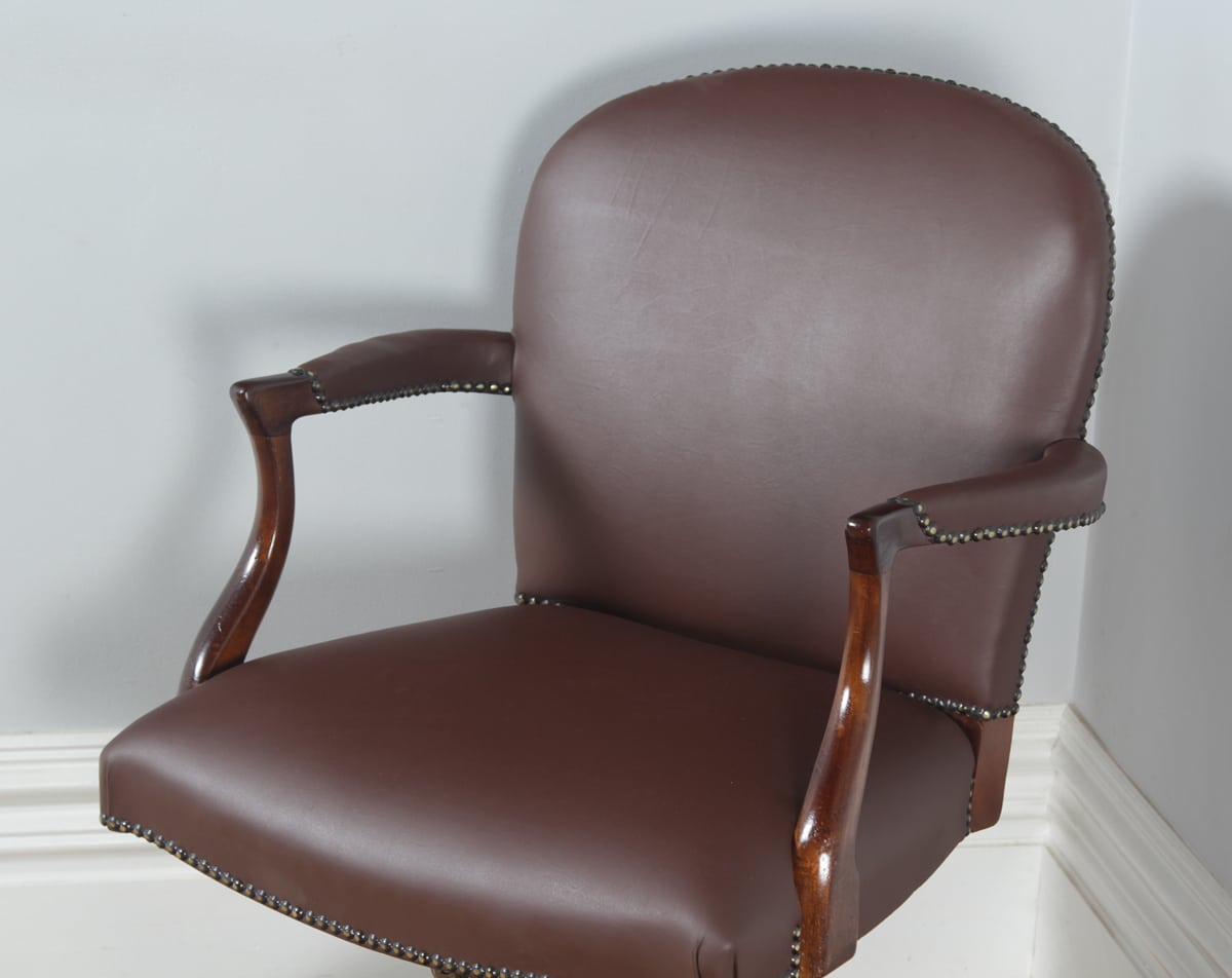 revolving chair for kitchen inflatable 90s target antique mahogany leather office desk by