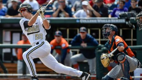 FILE- In this June 15, 2015 file photo, Vanderbilt's Bryan Reynolds hits a double that scored Zander Wiel in an NCAA College World Series baseball game against Cal State Fullerton in Omaha, Neb. Reynolds has had back-to-back 90-hit seasons and is one of the nation's top offensive players. (AP Photo/Mike Theiler, file)