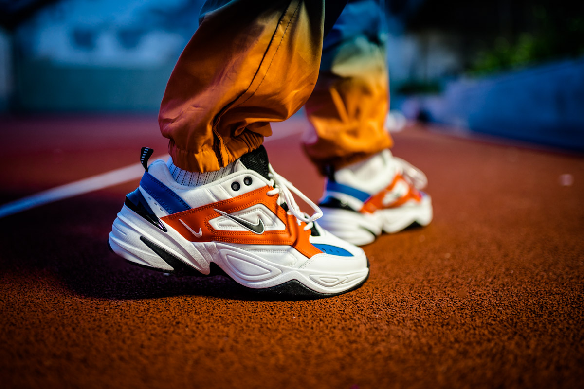 c8996ff16 ... switzerland dressed in orange blue white and black color scheme this  nike m2k tekno features a