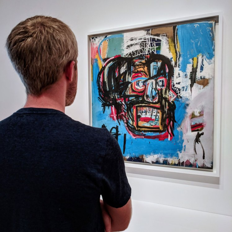 "Yonder Sky guide Daniel enjoying a temporary exhibition of Jean-Michel Basquiat's ""Untitled"" (1982) while visiting Seattle Art Museum"