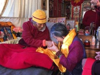 receiving-blessing-from-grandfather-Tashi-Dorje-Rinpoche