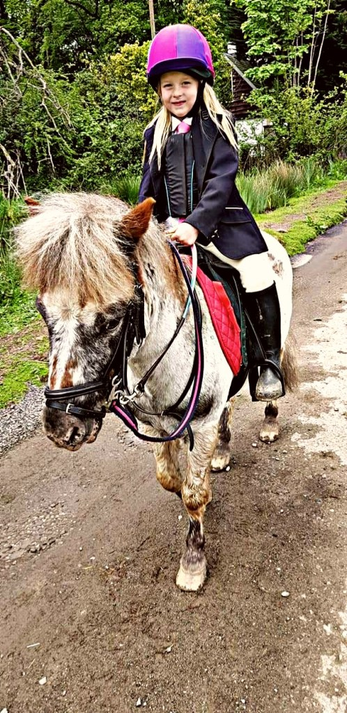Maisy at a local riding school fun day with her pony Migo.