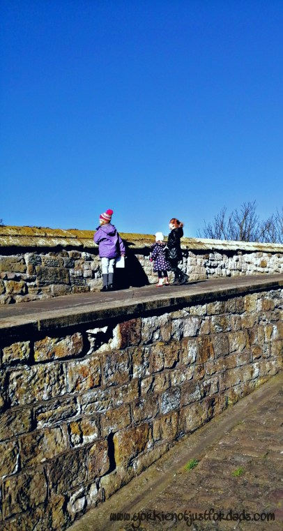 The princess tribe on the higher path with views of Scarboroughs north bay at Scarborough Castle.