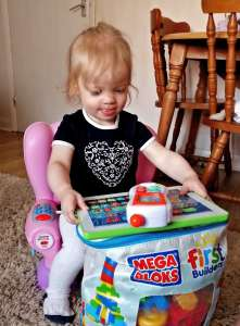 Beast has set up a little home office using her Fisher Price Laugh and Learn Smart Changes Chair.