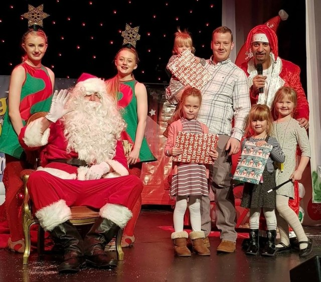 A photo of Me and My girls (before little Beast was Born) - at a christmas magic show with a local entertainer. Love the Dad/Step-dad life.