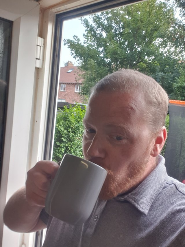 This image is of Me (Eddie) enjoying a nice cup of freshly brewed coffee while my daughter is engrossed in the Elmer the Elephant My First Floor Puzzle.