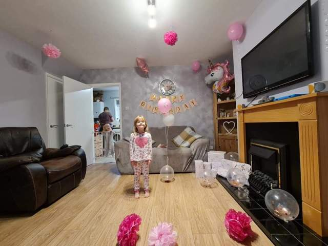 My daughter Pig in our living room decorated with banners and balloons. Happy Birthday my Daughter you are 5 today.