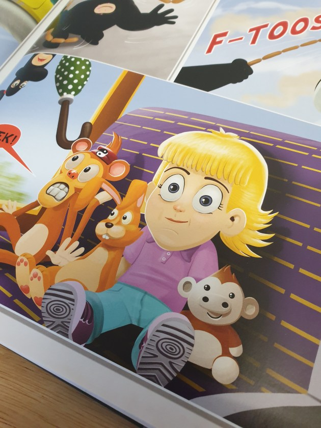 Lucy and her toys in Harry the Karate monkey.