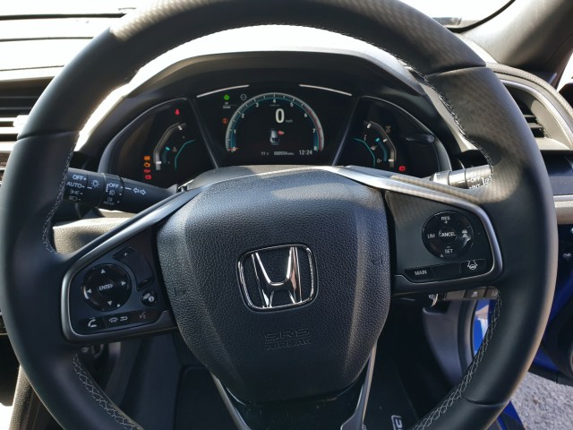The instrument cluster and steering wheel of the 2021 Honda Civic.