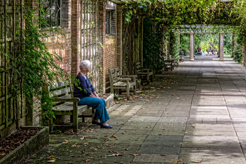 Lady In thought on Remembrance Bench