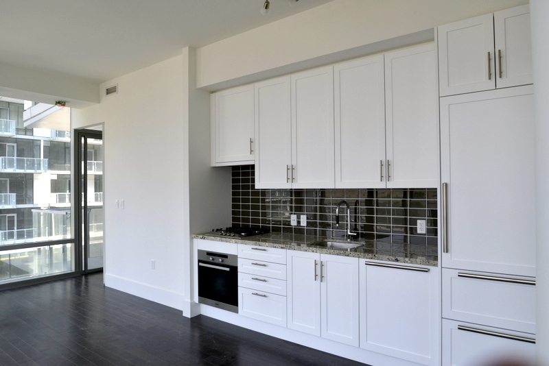 PIER 27 CONDO FOR SALE FOR RENT - WHITE KITCHEN