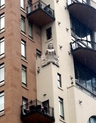 Bust on an old residential building.