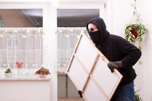 bigstock-thief-steals-a-painting-44621797_0