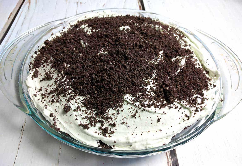 Super Easy No Bake Grasshopper Pie, entire pie in glass pie plate, ready to serve.