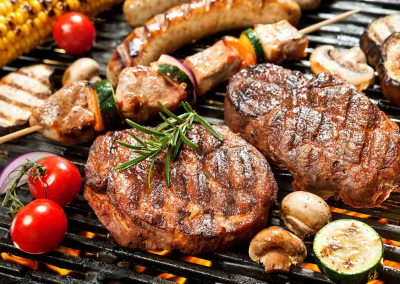 mixed bbq grill sausage, kebabs, cherry tomatoes mushrooms and steak