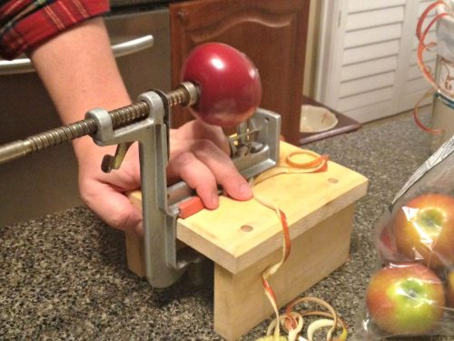 peeling apples with an old fashioned apple peeler