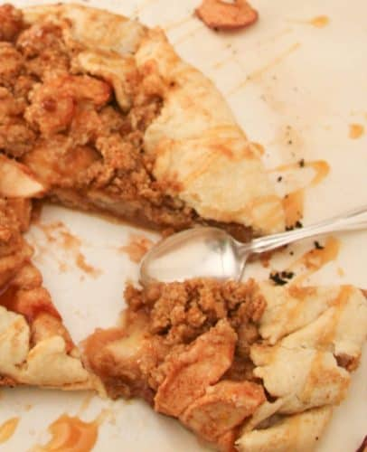 close up image of apple galette showing piece cut out and a spoon