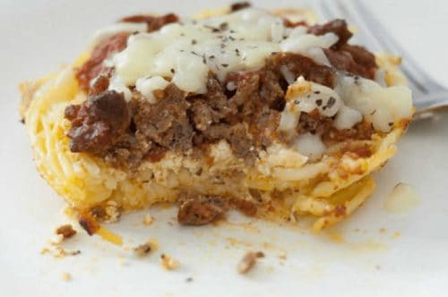closeup of partly eat mini spaghetti pie casserole