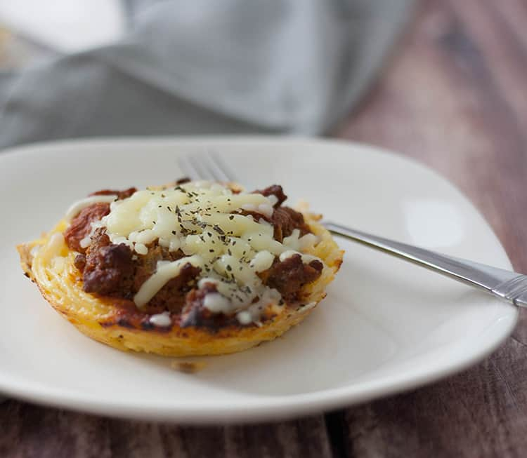 The Best Spaghetti Pie Casserole, an easy dish you can make in under 30 minutes makes a great supper dish your family will love! These mini spaghetti pies are great for lunches and freeze really well too!