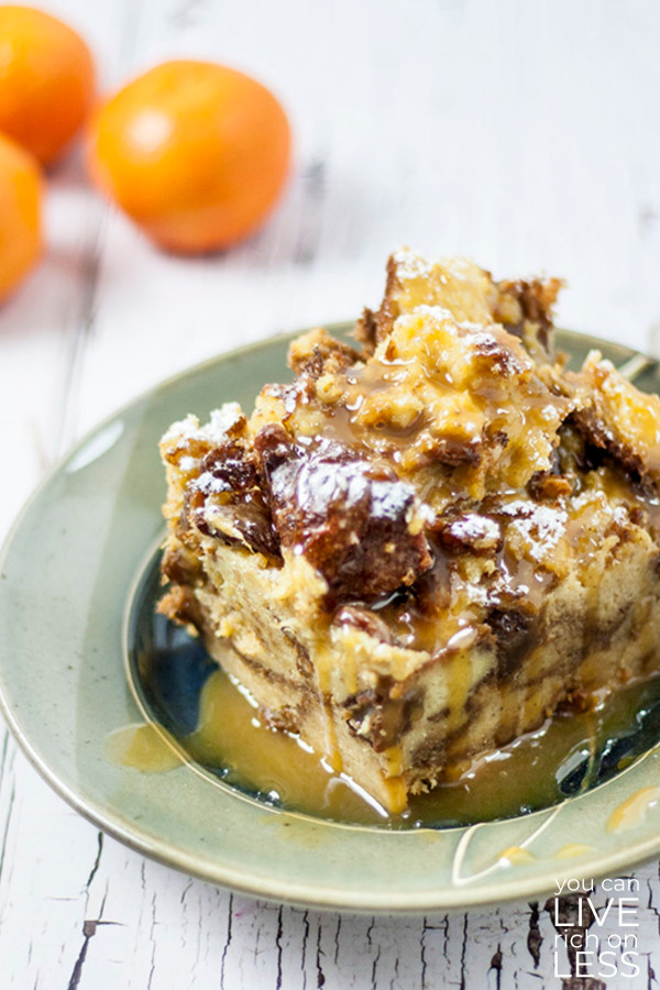slow cooker panettone bread pudding in brown dish with mandarins in background