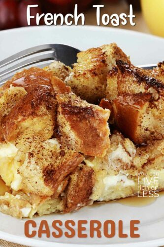 overnight french toast casserole served on a white plate with maple syrup with text french toast casserole