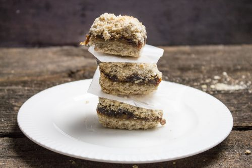 trio of homemade date squares on a white dessert plate