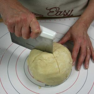 cutting the shaped dough into three sections