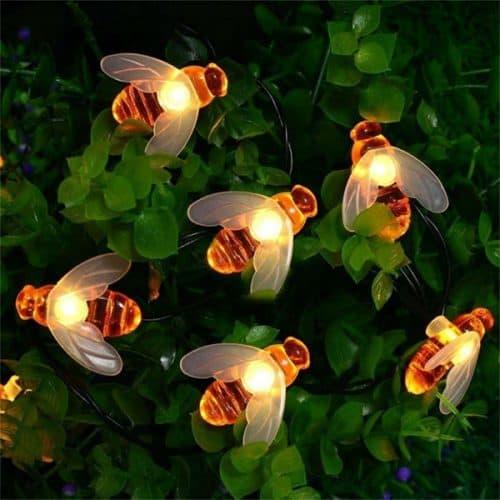 mini honey bee string lights on greenery