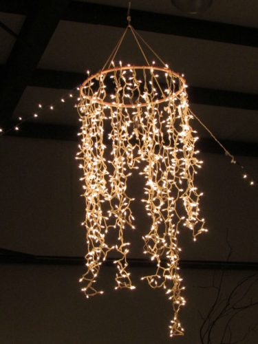 hanging circular frame with cascading fairy lights hanging down