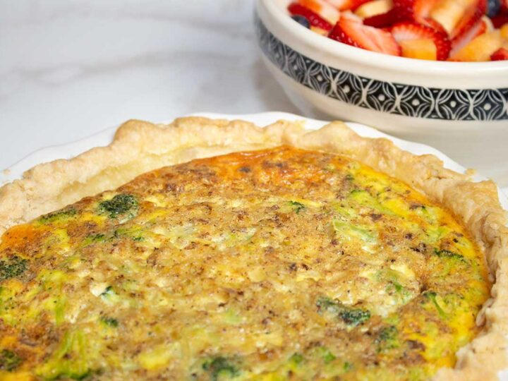 broccoli quiche ready to serve with fruit salad